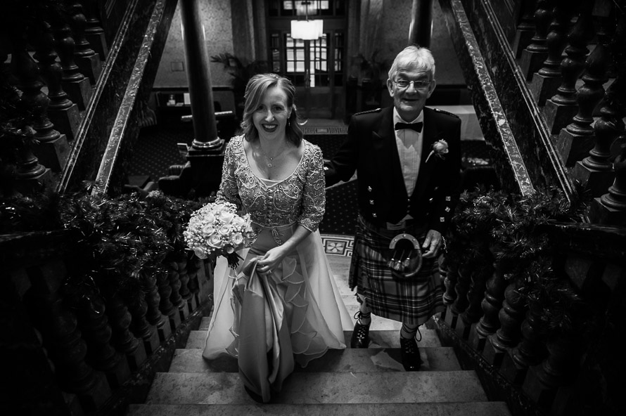 bride and father on marble stairs cathedral quarter hotel