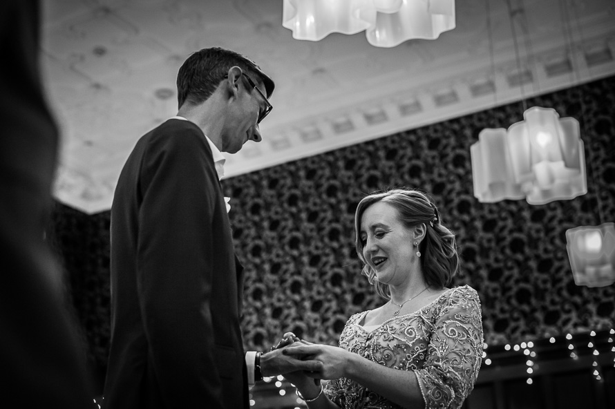 bride and groom exchange rings cathedral quarter hotel