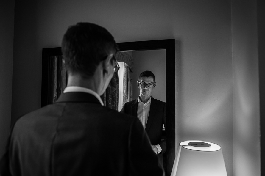 groom looking in mirror cathedral quarter hotel