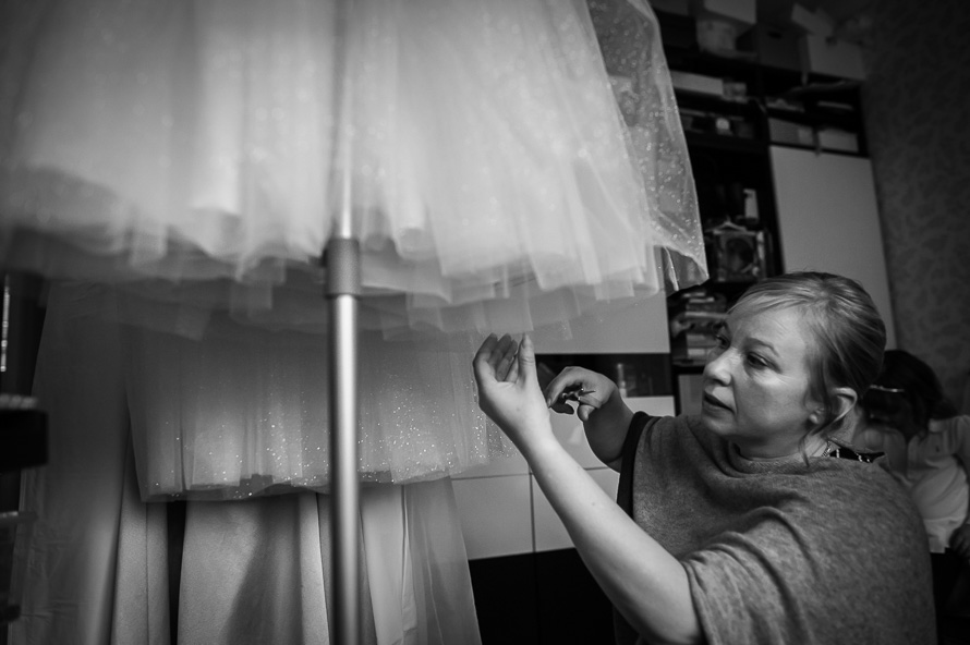 dressmaker checking wedding dress